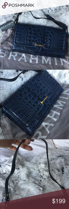 Brahmin Bryn Navy Melbourne Clutch Bag Beautiful navy croc embossed large clutch. Style is sold out. Adjustable drop in strap. Hidden magnetic closure. Interior divided into two pockets. New with tags. No defects. Brahmin Bags Clutches & Wristlets