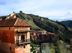 ALBARRACÍN, SPAIN Located in Aragon, this well-preserved medieval village sits high on a mountaintop 3,878 feet above the Guadalaviar River. The hilly town has narrow streets, stone fortress walls, orange clay buildings and Moorish towers.