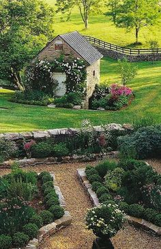 Lovely English country garden - garden beds are bordered with Belgium blocks, paths are gravel - so neat and very charming