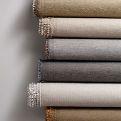 Twining is a direct glue wallcovering and panel fabric with the classic fine texture of a menswear suiting fabric. Developed on the handloom in our studio, it utilizes a tight basketweave structure with a fine two-color bouclé yarn. The seven neutral colorways create a clean vertical surface with a warm woven aesthetic.