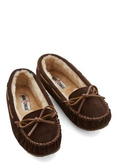Classically Cozy Slipper. After strutting around in heels all day, give your toes a rest in these suede slippers from Minnetonka! #brown #modcloth