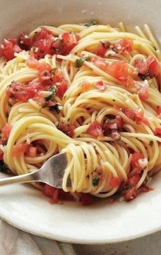 Pasta with Fresh Tomatoes, Basil, Garlic, Olive Oil, and Parmesan Cheese by pesado