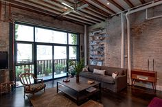 "Loft renovation by Reiko Feng Shui Interior Design | Stunning eclectic Feng Shui loft redesigned by Reiko Feng Shui Interior Design situated in a former warehouse in Brooklyn, New York.As so often happens in Brooklyn, a beautiful old warehouse had been poorly chopped up into a bunch of ""spec"" lofts. The developer had covered old brick walls and gorgeous beamed ceilings with sheet rock, removing all of the character and history."