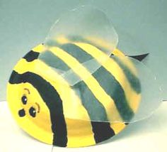 painting a paper plate to make a bee