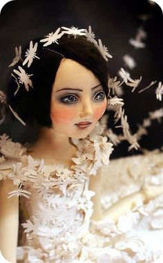 I would LOVE to own one of Christine Alvarado's gorgeous handmade one-of-a-kind dolls!!!  http://dubuhdudesigns.typepad.com/