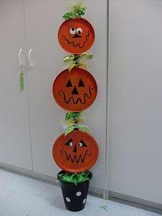 Pumpkin Totem Pole from plates  *Or stove covers & bucket.