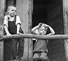 """Children living in a """"Company"""" House - West Virginia coal mine life during the 1930's was tough. The Coal companies used the miners to dig the coal, then turned around and rented them company houses and sold goods at the company store. As these photos show, the miners and their families practically worked just to keep alive, while the mine owners made a killing."""