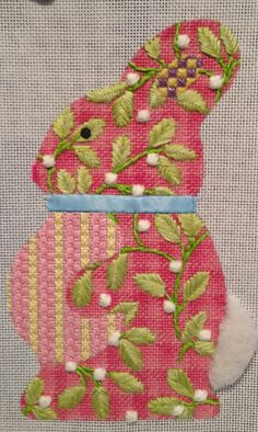 Really love the flowers and deep pink design - not so keen on the rest or the rabbit. needlepoint bunny rabbit