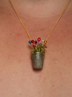 The Thimble Necklace Tutorial.  Match colored pins with birth stones?