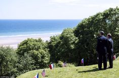 Blue: President Hollande and Barack Obama look out over beach and out towards the Channel ...