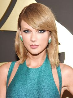 Taylor Swift's sleek bob and soft makeup.