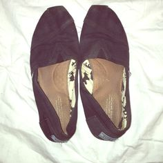 Black TOMS Worn black TOMS. Great price for these shoes! TOMS Shoes