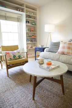 Living in a small space? Keep walls, ceilings and woodwork white to help maximize limited natural light, then add color with fun fabrics, painted furniture and personal mementos.