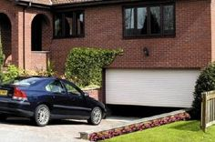 The Doorking Eclipse ... a high-end garage door providing noise and thermal insulation, a remote controlled motor, and other features - Total Price: £615.00