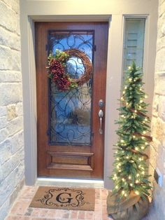 Cute pine tree in entryway. A simple ourdoor holiday decoration - Simply Fabulous Living