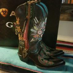 Gypsy Soule Ariat Boots SOLD OUT AMAZING 7 I'm not certain if I really want to part with these amazing boots but if the price is right... great condition with box, size 7. Vibrant colors, skull on front, Don't Walk In Fear on back, feathers  - what more could a cowgirl want??? Gypsy Soule Shoes