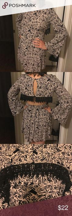 70s Inspired Flutter Sleeve Open Back Dress Only worn a handful of times. Fun, black and white dress with open back and black lace trim. Flared sleeves. True medium size.  *Tagged Nasty Gal for exposure. Nasty Gal Dresses Long Sleeve