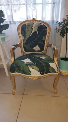 Super fashion chair with banana leaf tommy Bahama Fabric , and gold frame