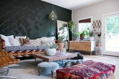 "We first spotted the layered, plant-filled home of Liz Kamarul in the #JungalowStyle feed on Instagram, and we immediately knew we needed to share it! Liz, a home stager, and her husband, Tim share their Portland, OR home with their dogs, Cudi and Bo. Liz describes their home as a ""moody, plant loving, bohemian retreat"" where …"