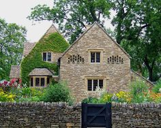 Rose Cottage ~ The oldest building in Greenfield Village was imported from England's Cotswold Hills to represent the area from which Henry Ford's ancestors immigrated. Built from limestone, it is surrounded by a limestone wall.