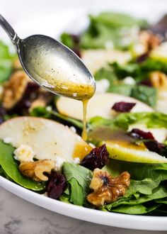 Apple cranberry spinach salad filled with greens, crisp apples, dried cranberries, walnuts, feta cheese and a delicious honey dijon dressing. An easy salad recipe that's full of flavor! Cranberry Spinach Salad, Simple Spinach Salad, Spinach Salad Recipes, Salad Recipes For Dinner, Easy Salads, Healthy Salad Recipes, Honey Dijon Dressing, Vinegar Dressing, Different Salads
