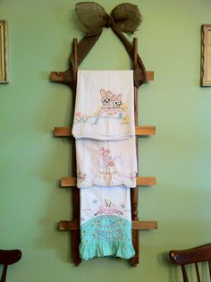 An old ladder made from left over spindles and scrap wood to display vintage pillowcases.