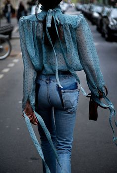This is such a pretty shade of turquoise, I love this delicate sheer blouse with the jeans.