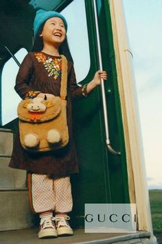 Pretty Gucci Girls brown long sleeve dress crafted from GG monogram cotton jacquard and colorful floral embroidery. Beige mini-me GG joggers. Retro look green and red Web stripe trims on both sides, and ivory ribbed knit cuffs with blue and red stripes. Shop designer girls clothes @ Childrensalon (affiliate). #gucci #guccigirl #girlsdress #childrensalon #dashinfashion Gucci Baby, Gucci Kids, Jogger Pants, Joggers, Girls Designer Clothes, Girls Special Occasion Dresses, Celebrity Kids, Gucci Fashion, Brown Floral