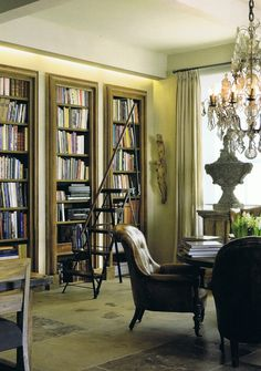 """Traditional study elements…the ladder, leather club chairs, a trio of classically moulded bookcases, simple drapery hardware…"" I WILL HAVE A TRADITIONAL STUDY AND LIBRARY."