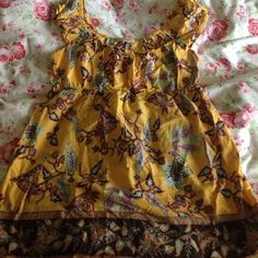 Yellow print baby doll Worn only 2 times! Super cute to pair it with jeans or shorts! Might keep it since it's so cute, so make me an offer I can't refuse :) Jump Tops