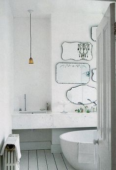 More mirrors in the bathroom. I really love this look.
