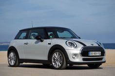 I'd love one of these white silver, black-topped mini coopers someday
