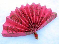 Make this pretty Chinese fan  from construction paper and paint stamps or color your own. It will make a great  craftivity, or decoration for  your Chinese New Year celebration!