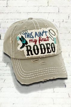 06b9f01f52960 This Ain t My First Rodeo in Distressed Khaki Decorative Ball Cap  Graphic  Baseball Hat   Bad Hair Day Baseball Hat