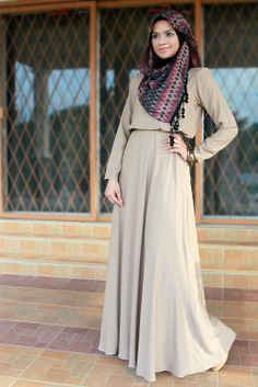 Hijabi Style Neutral flowing dress in beige with patterned scarf in matching neutral tones hint of red