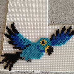 Perler bead parrot by Fuse Bead Patterns, Perler Patterns, Beading Patterns, Diy Perler Beads, Perler Bead Art, Beaded Cross Stitch, Cross Stitch Flowers, Fuse Beads, Beads And Wire