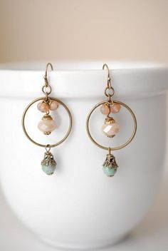 Gaia blends a bohemian aesthetic with a collage of materials in muted spring colors. These unique handmade artisan gemstone dangle hoop earrings for women are no exception, with gemstones on antique