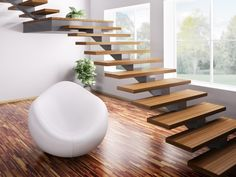 Wooden minimalist staircase with landing and white armchair http://www.inspiredhomeideas.com/modern-home-staircase-designs/
