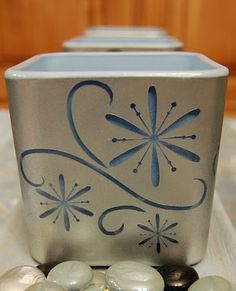DIY - Shimmering Candle Holders - Using vinyl stickers & 2 spray paint colors on a plain glass votive or tlight holder.