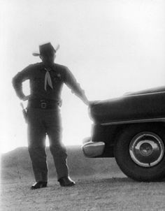 A Nevada sheriff standing against the light from an atomic blast 40 miles away    Operation Teapot, photo by George Silk for LIFE, 1955