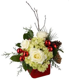 Send them love and joy with a bouquet of white Roses and Hydrangea arranged in a red cube vase. Accents include pine cones and red ornament balls. Christmas Urns, Christmas Planters, Christmas Flowers, Christmas Table Decorations, Christmas Holidays, Christmas Brunch, Winter Floral Arrangements, Christmas Flower Arrangements, Beautiful Flower Arrangements
