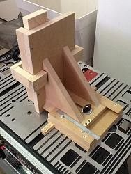 "Tenon Jig by markfitz -- This is a jig that I put together to help me make better mortise and tenon joints. This little fixture has really improved the accuracy of my tenons.  I cut out a runner to slide in the T-rail on the saw in the X axis, parallel with the saw blade. A cross slide is fixed to the runner that allows the user to set the position of the workpiece to an accuracy of 1/64"" in the Y axis, perpendicular to the blade.  The height of the cut, which determines the depth of the..."