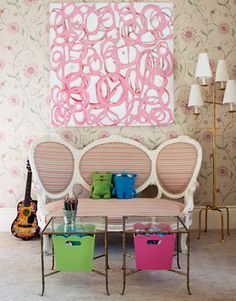 In designer Melissa Rufty's New Orleans home, a pink scribble painting by Amanda Talley hangs on floral wallpaper in a girl's bedroom... So glamorous