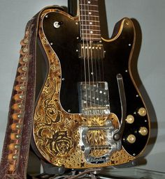Gold and black guitar