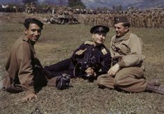 Two American soldiers with a Red Army soldier relaxing in Linz, Austria.
