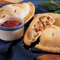 Pasties, or meat pies.  Popular up in Michigan.  Use pie crust to make it easier.