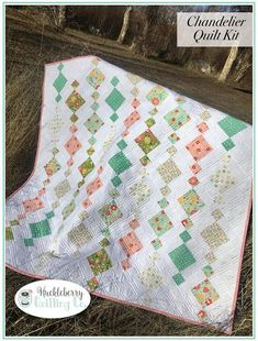 Gorgeous quilt kit to make Chandelier Quilt with Flower Mill fabric by Corey Yoder for Moda Fabric. Finished quilt measures approx. 60x60. Flower Mill Corey Yoder Moda United Notions Quilt Kit Includes: 7 Flower Mill Fat Quarters 3 yards background fabric Confetti Cottons White 1
