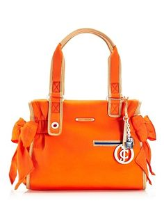 I just caved in and bought this.  Juicy Couture // handbag // Neoprene Ms. Daydreamer // Vermillion // cute // love // <3