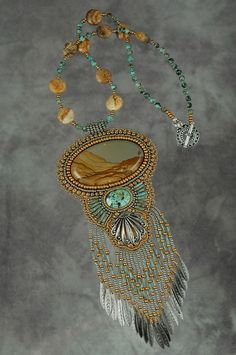 Bead embroidered stone pendant necklace by Sue Horine (sedonaskye on Etsy)