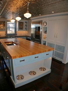 Dog bowls and storage AND I'm also in love with this kitchen...